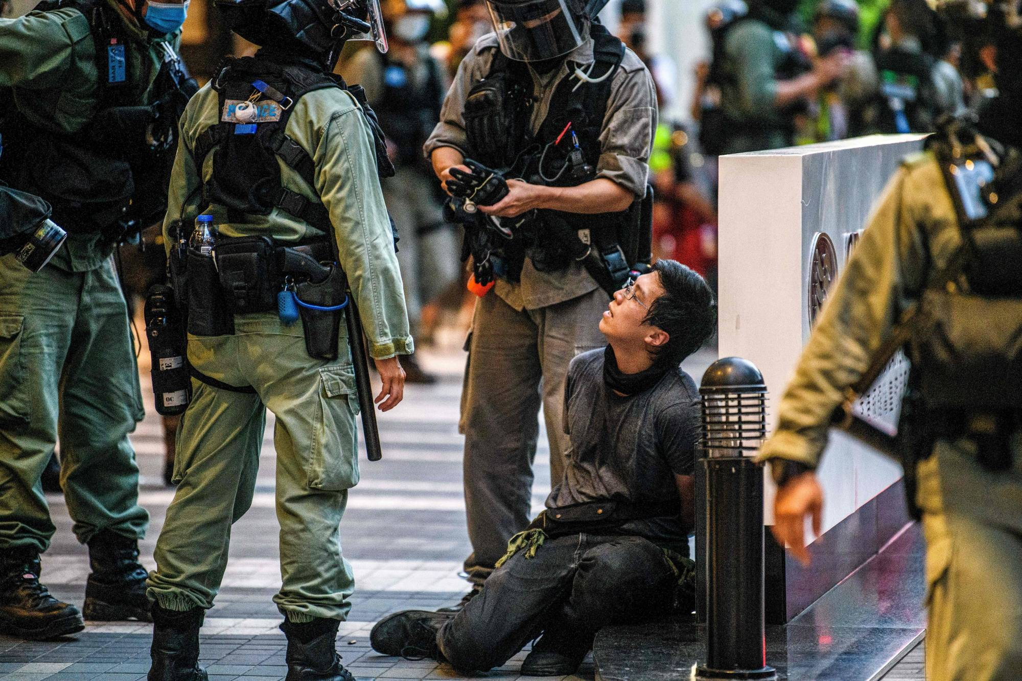 A protester is detained by police during a rally against a new national security law in Hong Kong on Wednesday.  | AFP-JIJI