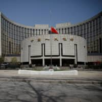 As the economy shows signs of recovery, the People's Bank of China is slowing down its monetary easing. | REUTERS