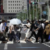 Tokyo reported 107 coronavirus cases Thursday, the highest the capital has seen since May 2. | AP