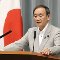 Chief Cabinet Secretary Yoshihide Suga speaks at a news conference Friday at the Prime Minister's Office. | KYODO