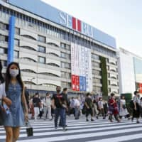 A large portion of new infections have been traced back to nightlife destinations in Tokyo's Ikebukuro and Kabukicho districts. | KYODO