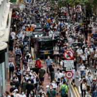Anti-national security law protesters march at the anniversary of Hong Kong's handover to China from Britain in the financial hub on Wednesday.   | REUTERS