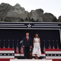 U.S President Donald Trump and First Lady Melania Trump attend Independence Day events at Mount Rushmore in Keystone, South Dakota, on Friday.  | AFP-JIJI