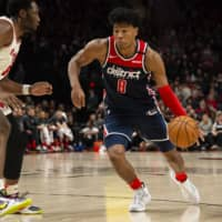 Wizards forward Rui Hachimura drives against the Trail Blazers' Caleb Swanigan during the second half of a game on March 4 in Portland. | USA TODAY / VIA REUTERS