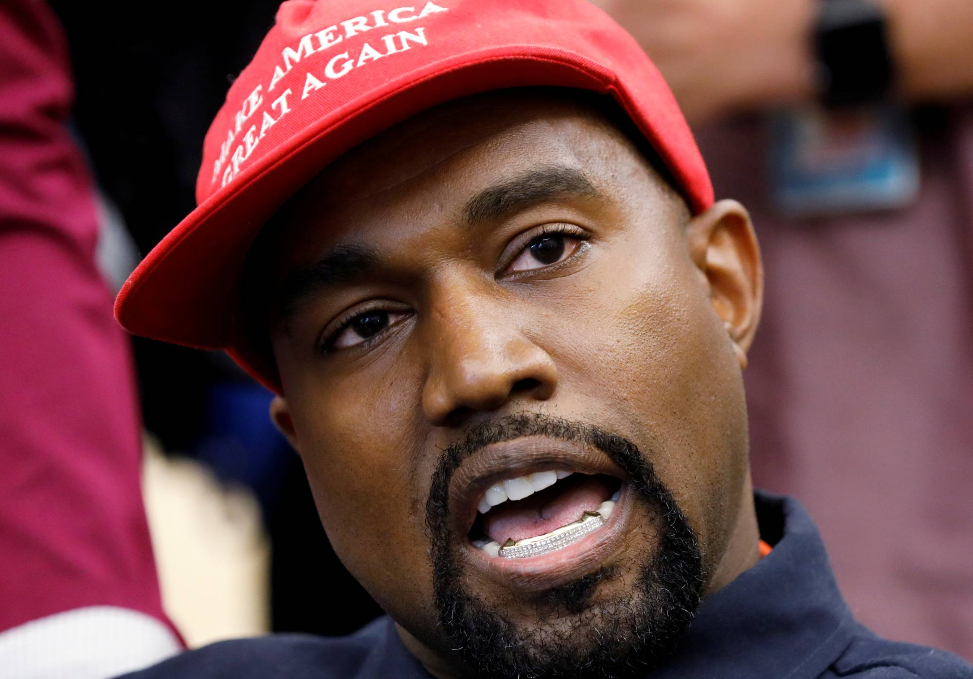 Musician Kanye West speaks during a meeting with U.S. President Donald Trump to discuss criminal justice reform in the Oval Office of the White House in Washington in October 2018.  | REUTERS
