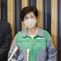Tokyo Gov. Yuriko Koike speaks to reporters in Tokyo on Saturday, following a meeting with economic revitalization minister Yasutoshi Nishimura. | KYODO