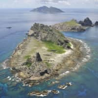 A photo taken in September 2012 shows the Japan-controlled Senkaku Islands in the East China Sea. Taiwan and China claim the uninhabited islands as their own. | KYODO
