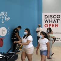 New Jersey's indoor shopping malls reopened on June 29 after COVID-19 shutdowns. U.S. employers likely rehired several million more workers in June, but the most up-to-date data suggests that a resurgent coronavirus will limit further gains.  | AP