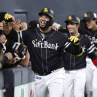 The Hawks' Wladimir Balentien celebrates after hitting a three-run home run against the Fighters on Thursday at Sapporo Dome. | KYODO