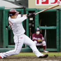 The Eagles' Hideto Asamura hits a three-run home run against the Marines on Sunday in Sendai. | KYODO