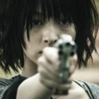 Aim true: Kyooko Hinami plays a trigger-happy woman bewitched by the power of an abandoned revolver in 'The Gun 2020.' | © YOSHIMOTO KOGYO