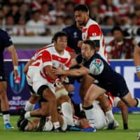 Scotland's Greig Laidlaw (right) competes against Japan during the Rugby World Cup on Oct. 13, 2019, in Yokohama. | REUTERS