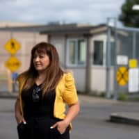 Sandra Videla, whose Guatemalan husband, Timoteo Vicente-Chun, is detained at the Northwest ICE Processing Center, poses outside the facility in Tacoma, Washington. | REUTERS
