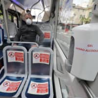 Face masks are mandatory on public transport in France, where the COVID-19 outbreak has claimed nearly 30,000 lives.   REUTERS