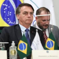 Brazil's Bolsonaro undergoing coronavirus test after showing symptoms
