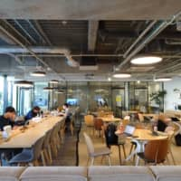 People study in a common area of a student-accommodation facility run by GSA Star Asia KK in Tokyo's Hakusan area in January. | KAZUAKI NAGATA