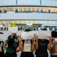 Arrested under new law, Hong Kong protesters get swabbed for DNA