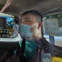 Tong Ying-kit, 23, arrives at a court in a police van in Hong Kong Monday. Tong was the first person to be charged under the new national security law, for allegedly driving a motorcycle into a group of policemen while bearing a flag with the 'Liberate Hong Kong, revolution of our time' slogan.  | AP