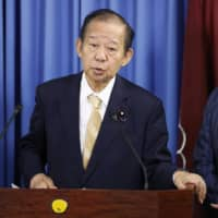 Toshihiro Nikai, secretary general of the Liberal Democratic Party, has objected to a draft resolution that calls for the cancellation of a visit to Japan by Chinese President Xi Jinping. | KYODO
