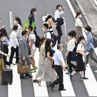 Tokyo Gov. Yuriko Koike has urged residents not to travel beyond the capital's borders to curb new infections. | KYODO