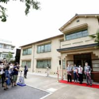 Officials celebrate the opening of the Tokiwaso Manga Museum in Tokyo on Tuesday. | KYODO