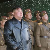 North Korean leader Kim Jong Un oversees a missile launch in March. | KYODO