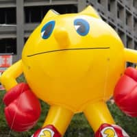 A contemporary image of Pac-Man appears in a Thanksgiving Day parade in Houston, Texas, in November 2019. | GETTY IMAGES