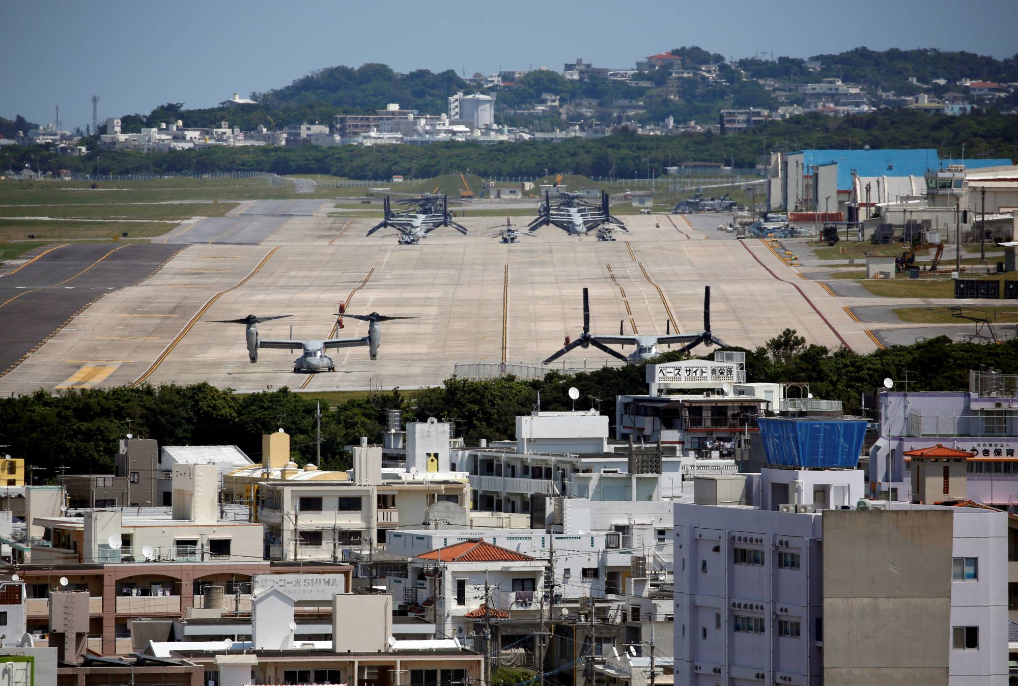 MV-22 tilt-rotor Ospreys are seen at the U.S. Marine Corps' Air Station Futenma in Ginowan, Okinawa Prefecture, in March 2018. | REUTERS
