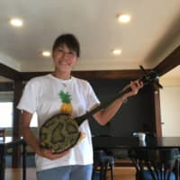Rika Hisai and her husband currently provide shamisen lessons, something synonymous with Amami Oshima in Kagoshima Prefecture. | KATHRYN WORTLEY