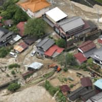 An aerial photo shows a residential area in Gero, Gifu Prefecture, on Wednesday morning after it was hit by mudslides. | KYODO