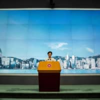 Hong Kong Chief Executive Carrie Lam speaks to the media about the new national security law on Tuesday.  | AFP-JIJI