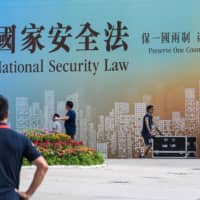 Over the past week, Hong Kong authorities have begun explaining how they'll enforce a law that officials in Beijing called a 'sword of Damocles' hanging over China's most strident critics. | AFP-JIJI