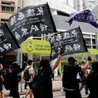 Hours after Hong Kong announced sweeping new powers to police the internet under a controversial new national security law, major U.S. tech companies suspended requests for data from the Hong Kong government. | REUTERS