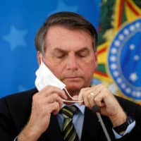 Brazilian President Jair Bolsonaro has pushed his government to make hydroxychloroquine widely available and encouraged Brazilians to take it. | REUTERS