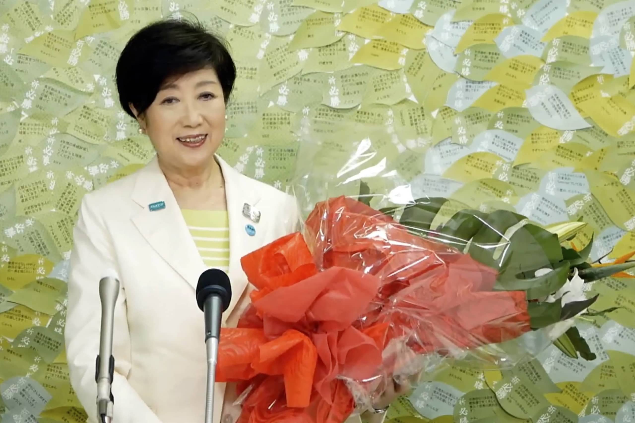A divided opposition and the coronavirus crisis helped propel Tokyo Gov. Yuriko Koike to victory in Sunday's election. | KOIKE YURIKO OFFICIAL CHANNEL / VIA AP