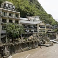 Tenryuso, a traditional hot-spring inn in the Amagase resort, was severely damaged by the heavy rain in the Kyushu region. | KYODO