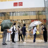 Fast Retailing cuts profit outlook as pandemic hits Uniqlo sales