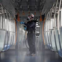 Is that hand strap clean? Tokyo Metro sprays silver to fend off coronavirus