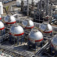 LPG tanks stand at an energy plant in Ichihara, Chiba Prefecture. Wholesale prices in Japan fell 1.6 percent in June due to weak demand for a variety of products amid the coronavirus pandemic.   KYODO