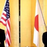 Defense Minister Taro Kono and U.S. Deputy Secretary of State Stephen Biegun meet on Friday in Tokyo. The cancellation of the Aegis Ashore system means Japan must come up with an alternative plan for missile defense. | AP