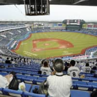Spectators watch a game between the Marines and Lions at Zozo Marine Stadium in Chiba on Friday. It was the first day fans were allowed into NPB stadiums following the relaxation of rules put in place in response to the coronavirus pandemic. | KYODO