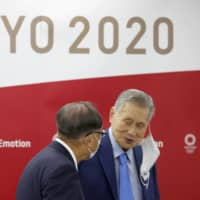 Yoshiro Mori, president of the Tokyo 2020 Olympic Games Organizing Committee, attends an Executive Board meeting in the capital on June 12. | KYODO