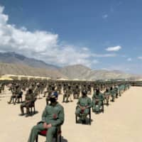 Indian soldiers await a visit by Prime Minister Narendra Modi in the Himalayan desert region of Ladakh on July 3.   ANI / VIA REUTERS