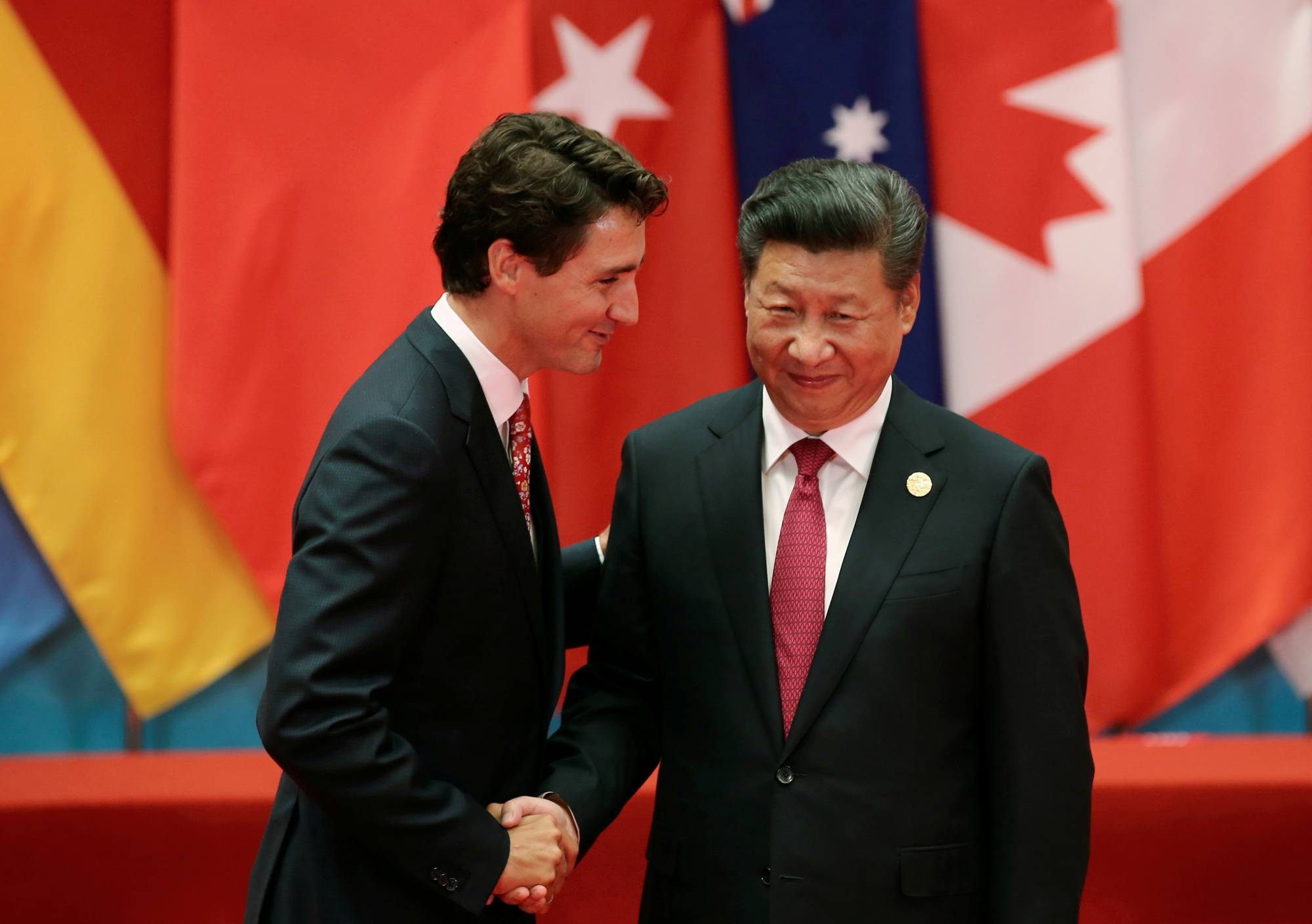 Chinese President Xi Jinping shakes hands with Canadian Prime Minister Justin Trudeau during the G20 summit in Hangzhou, China, in September 2016.  | REUTERS