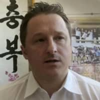 Michael Spavor, pictured in 2017, has spent 18 months in a Chinese prison following an arrest that is widely believed to be retaliation for the detainment in Canada of Huawei executive Meng Wanzhou.  | AP