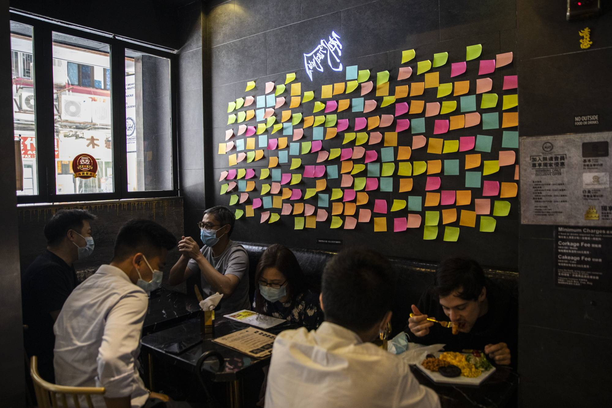 Blank sticky notes are displayed on a Lennon Wall inside a restaurant in Hong Kong on Wednesday. | BLOOMBERG