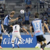 Frontale's Akihiro Ienaga (second from left) scores his team's first goal against Kashiwa on Saturday in Kawasaki. | KYODO