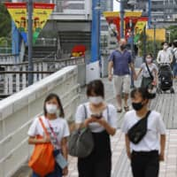 Japan urges urbanites to tour country, sparking fear of virus's spread in countryside
