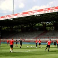 Fortuna players warm up before a game at Stadion An der Alten Forsterei, home of Union Berlin, on June 27 in Berlin. | POOL / VIA REUTERS