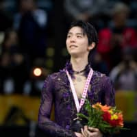 Yuzuru Hanyu stands on the podium after winning the men's competition at Skate Canada on Oct. 26 in Kelowna, British Colombia. Hanyu was named Most Valuable Skater for the 2019-20 season in the inaugural ISU Skating Awards on Saturday. | USA TODAY / VIA REUTERS